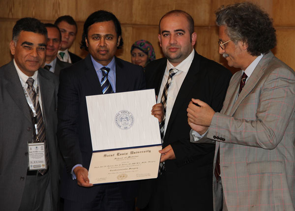 The first graduate of the Saint Louis University Department of Neurosurgery Global Young Neurosurgeons Leadership Development Program, Dr. Ehab Ali (center right), was presented the Fellowship Certificate by Dr. Abdulrauf (center left).  Also pictured are Professor Elgohary (far left), Chairman of the Department of Neurosurgery at Cairo University, and Professor Khairy (far right), Dean of Faculty of Medicine at Cairo University.