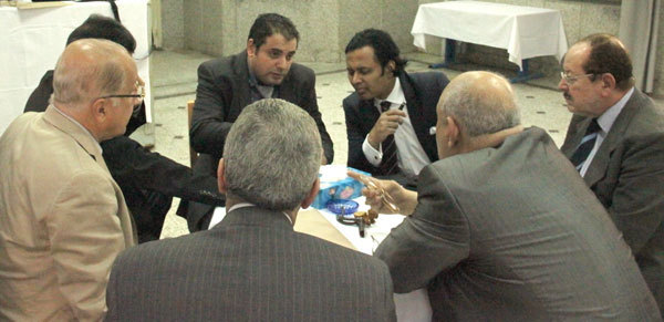 "Dr. Abdulrauf served as an external examiner for Egypt's 2-day oral neurosurgery board examination held at Cairo University.  (Pictured is Dr. Abdulrauf (top right) examining a candidate (pictured left of Dr. Abdulrauf), along with a group of senior Professors of Neurosurgery from Egypt).  Dr. Abdulrauf commented the examination of the candidates was ""detailed and fair""."